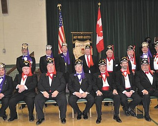 At a Jan. 14 ceremony at St. Luke's Hall, the 2012 officers of Aut Mori Grotto were installed by Past Grand Monarch Edwin Shawver, assisted by Marshal Ed Grisa and Chaplain Tom Wright. In the first row, from left, are Treasurer Sean Craig, Orator George Brainard, Chief Justice Al Boles, Monarch George McClelland, Master of Ceremonies Ray Bishop, Venerable Prophet Mike Dankovich and Secretary Ron Craig. In the second row are the trustees: Gary Lippert, Grisa, Wright, Gary Brant, Marshal Dave Powell, Captain of the Guard Charles Graham and Sentinels Glenn McClain and J.J. Losasso. Absent from the photo is Chaplain John Tyree. Aut Mori Grotto, as well as the other grottoes of North America, is dedicated to charity and the care of others.