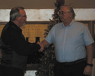 Wayne Holton, left, zone governor of the Berlin Ellsworth Ruritan Club, welcomed the group's newest member, Walter Overly, on Dec. 12 at A la Cart Catering in Canfield. Overly is a retired technician and has lived in Berlin Center for 19 years. He also is a member of the Berlin Center Crime Watch.