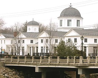 The Poland Library, built in 2001, sits along the Yellow Creek.