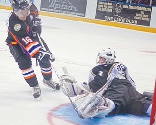 The Youngstown Phantoms' Ryan Belonger (16) scores on Muskegon goaltender Hayden Stewart during a shootout at Sunday's game at the Covelli Centre. The Phantoms fell 4-3.