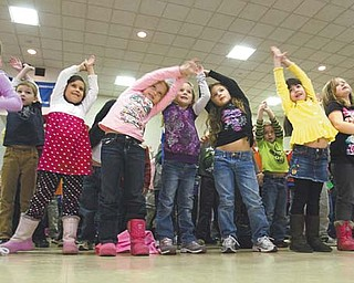 "Poland Union Elementary students stretch and dance Wednesday during a Radio Disney dance party. Union is one of 20 schools in Ohio to win the ""Anthem Blue Cross and Blue Shield Get Active, Get Fit School Challenge"" sponsored by Radio Disney."