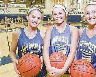 Lowellville High's girls basketball team has three 1,000 point scorers. From left are seniors Emily Carlson, Ashley Moore and Taylor Hvisdak.