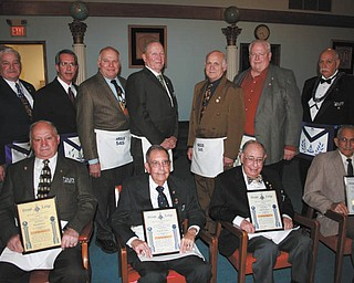 Argus Lodge 545 of Canfield recently honored some of its members for outstanding service. Pictured from left to right, sitting, are Emanuel Cominos, David R. Gundry, Arthur T. Gundry and Robert W. Luth. Standing are John Martin, Douglas F. Anstrom, Eric R. Cahalin, James R. Brown, Laszlo D. Dundics, Ronald W. Martin and Thomas J. Hallden.