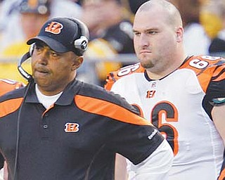 Cincinnati Bengals offensive lineman Mike McGlynn (66) stands on the sidelines with coach Marvin Lewis during the fourth quarter of a game against the Pittsburgh Steelers. McGlynn is a free agent this off season.
