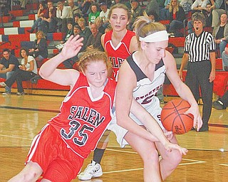 Ashley Hefferon, right, of Struthers tries to keep the ball as Raegan Meals (35) of Salem goes for a steal during Monday's Division II sectional tournament game. The Wildcats advanced with a 66-40 victory.