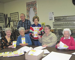 "A group of Niles Historical Society members are stuffing envelopes for the sale of ""streak free"" microfiber cloths, a new venture designed to fund the New Research/Lecture Center Building at the Ward-Thomas Museum. Seated from left are Julie Miscevich, Betty Whitney, Pat Pfeifer and Ruth Van Huffel. Standing are George John and Nancy Malone."