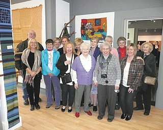 "The Trumbull Art Gallery, 196 E. Market St., Warren, is featuring an exhibit during the month of February in the West Gallery by the Youngstown Area Weavers Guild. Members met Feb. 5 at the gallery to open the show, called ""Weaving, Fibers & Such,"" which highlights the versatility of the group with creations done in traditional hand weaving, tapestry, hand spinning, knitting, felting, basketry, lace making, off-loom weaving and gourd work. Attending were, front row, from left, Carolyn Furnish, Marge Hepburn, Mary Ann Shrodek, Mary Ferguson, Sally Macklin and Patricia Zander. Back row, Howard Huffman, Shelly Marchand Cassidy, Liz Andraso (president), Nancy Marshall, Marilyn Dunn, Lois Romito, Mary Ann Gasper and Mimi Sniderman. Absent from the picture were Cherrie Mogul and Ken MacMillan."