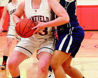 Sarah Vrabel (23) of Canfield tries to get drive around Streetsboro defender Shania William (10) during a Division II first-round sectional basketball game Wednesday at Austintown Fitch High School. The Cardinals slipped past the Rockets, 36-27.