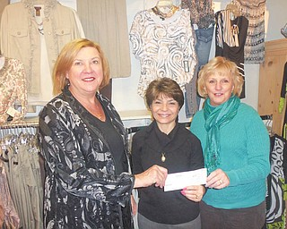 Easter Seals Holiday Brunch: After the 2011 Angels of Easter Seals Holiday Brunch, Possessions owner Linda Deckant, left, presented a $400 check 