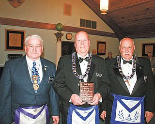 Brother Denny Furman, center, longtime member of Argus Lodge 545 F.&A.M., was honored recently with the E. Tom Brown Memorial Award. RWB John Martin, left, and WB Thomas Hallden, right, are shown with Furman.