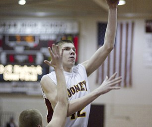 William d Lewis the vindicator  Mooney's Doug Caputo shoots over Greg Santullo of Hubbard during Monday action at Boardman.