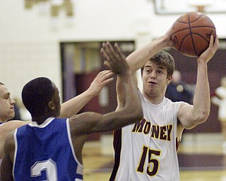 William d Lewis the vindicator  Mooney's PJ Quinnshoots over Darnell Tateof Hubbard during Monday action at Boardman.
