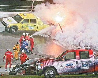 Emergency workers put out a fire on a jet dryer after it was struck by Juan Pablo Montoya's car in Lap 160 of the Daytona 500 on Monday at Daytona International Speedway. Trumbull County native Dave Blaney was leading the race when it was halted with 40 laps to go. It had not restarted by press time.