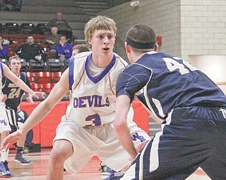 Lowellville's Dean Donatelli (42) is closely guarded by Western Reserve's Tim Cooper (3) during the