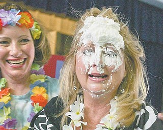 "Debbie Calcagni, kindergarten teacher at Watson Elementary in Austintown, took a pie to the face Friday during a special assembly for the students. Calcagni was one of 10 teachers to be pied as a ""thank you"" to the student body, which raised money during a three-weeklong campaign for Pennies for Patients."