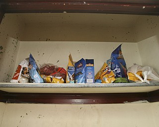 JESSICA M. KANALAS  | THE VINDICATOR..A shelf full of dog treats sits in a closet packed with bags of dog food and other pet necessities.