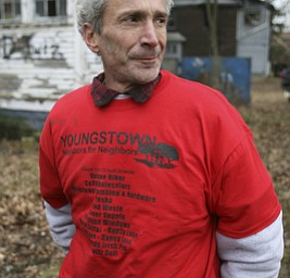 JESSICA M. KANALAS  | THE VINDICATOR..Rik Blake, new to the North side, wheres one of 100 t-shirts donated to the Youngstown Neighbors for Neighbors group.