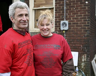 JESSICA M. KANALAS  | THE VINDICATOR..Blake and volunteer Connie Lauderdale, who helped organize the work day, stand in the backyard where volunteers from the community came to clean up despite the brisk wind and cold temperatures.