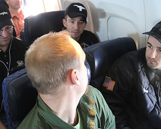NewsOutlet Student Editor Doug Livingston, left, interviews Sean Nagel Mueller, 27, of Victoria, Texas. Mueller was flying home  after working his regular two-week stint with an oil company in Pennsylvania.