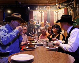 Jack Edmondson, left and Ken Morgan, right, of Fort Worth, along with a handful of friends, enjoyed dinner Wednesday night at Cattlemen's Steakhouse in the city's Historic Stockyards District. The group gets together weekly to discuss the area's hot topics, which often consist of the Barnett Shale, a major natural-gas geologic formation. Wednesday's topic focused on natural-gas vehicles.
