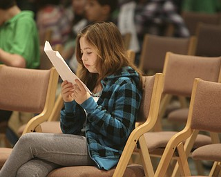 ROBERT  K.  YOSAY  | THE VINDICATOR --..Tessa Durrett of Struthers Elementary  studied  just before the start of The 79th  Regional Spelling Bee sponsored by the Vindicator was held at YSU Kilcawley Center with 65 spellers vieing for the coveted trophy and trip to Washington for the National Spelling Bee s--30-..(AP Photo/The Vindicator, Robert K. Yosay)