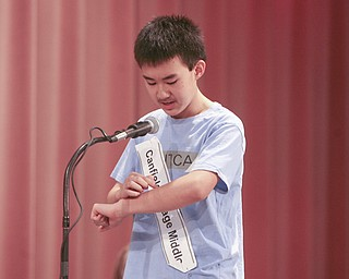 ROBERT  K.  YOSAY  | THE VINDICATOR --..I ARM -  Max Lee from Canfield Village Middle School  uses his forearm to visual words as he spelled them -  He eventually won the bee-.The 79th  Regional Spelling Bee sponsored by the Vindicator was held at YSU Kilcawley Center with 65 spellers vieing for the coveted trophy and trip to Washington for the National Spelling Bee s--30-..(AP Photo/The Vindicator, Robert K. Yosay)