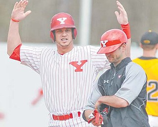 Youngstown State's Marcus Heath raises his arms in celebration after driving in the tying run in the bottom of the ninth inning during Sunday's game against Horizon League rival Milwuakee at Eastwood Field in Niles. The Penguins defeated the Panthers, 4-3, in 11 innings.