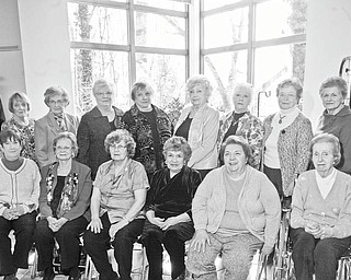 Photo by William D. Lewis | The Vindicator: Mahoning Garden Club was organized in 1927 and current members are celebrating its 85th anniversary. Seated, from left to right, are Joyce Cervone of Boardman, vice president; Barbara Wigle, Youngstown; Mary Jane Harbison, Hubbard; Frances Kupec, Youngstown; JoAnn Ziemianski, Boardman; and Marian Glover, Youngstown. Standing are Carol Bigelow, Youngstown; Barbara Anzivino, Youngstown; Jo-Ann Kaschak, Canfield; Marilyn Chiu, Canfield; Joanne Lewis of Hubbard, president; Delores Didden of Canfield, treasurer; Mary Ann Anderson, Canfield; and Dorothy DeChicco of Canfield, secretary. Absent from the picture are Wayla Agee, Youngstown; Bea Armbrecht (associate member), Collingwood, Ontario; Lois Boulis, Canfield; Sharyn Fees, Poland; Laura Mastro, Austintown; and Judy Malone, Poland.