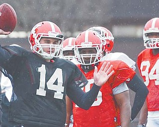 With Kurt Hess firmly entrenched as the starter and Marc Kanetsky graduated, Pat Angle (14) has the early edge on redshirt freshman Dante Nania for the job as backup quarterback for the Youngstown State Penguins come fall.