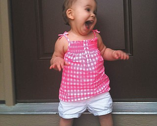 Now that is one happy baby! Picture sent in by Richard Pesce.