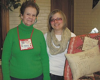 Ohio Star Quilters' March meeting featured Kory Turner, right, from Olive Grace Studio in Cortland. She spoke on handwork. Club president Peggy Ferenchak is at left. Plans are underway for the group's 25th annual Quilters' Day Out event that will take place May 2.