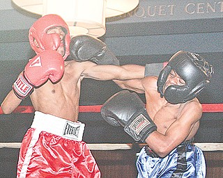 Terrance Holloway (red) from Farrell and Jamir Fudge of Warren Harding battle during their flyweight battle Monday night in the finals of the K.O. Drugs High School boxing tournament. Holloway won the championship with an unanimous decision in the event at St. Lucy Palermo Banquet Center in Campbell.