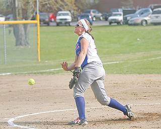 Western Reserve's Sissy Stubbs begins pitching in the first inning of Tuesday's ITCL showdown against Jackson- Milton. Stubbs pitched the Blue Devils to a 7-4 victory.