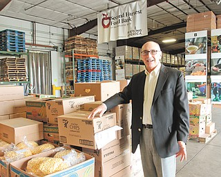 Michael Iberis, executive director of Second Harvest Food Bank of the Mahoning Valley, flashes a million-dollar smile as he stands in the food bank's warehouse at 2805 Salt Springs Road, Youngstown.