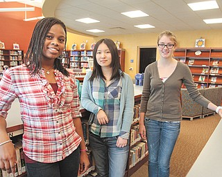 JoAnn Gernah of Nigeria, left, Yuxuan Li of China and Liane Herlitz of Germany are exchange students studying at Hubbard High School. The girls were placed by the organization Academic Year in America, which places students throughout the Youngstown area.