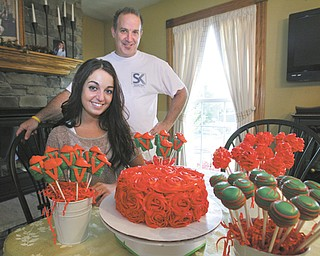 Fitch senior Alexa Diana, 17, with the help of her father, Pat Diana, has baked and decorated nearly 100 Kentucky Derby-themed cake pops that are being taken to Churchill Downs for Saturday's race. Among the fans of Alexa's Lil Baby Cakes business is the family of Youngstown businessman Bruce Zoldan. Zoldan is part-owner of the thoroughbred Went the Day Well, which is one of the 21 horses in this year's race.