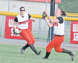 Youngstown State's Jordan Ingalls, right, catches a pop fly with backup from Haley Thomas during the second game of Thursday's doubleheader against the Robert Morris Colonials at McCune Park in Canfield. The Penguins lost both games, 8-0 and 12-4, respectively.