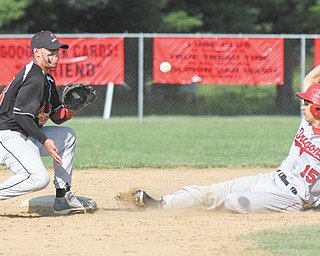 James Tate of Niles steals second base ahead of the throw to Canfield's Joe Tuchek during Thursday's baseball game in Canfield. The Red Dragons edged the Cardinals, 7-6, to clinch a share of the All-American Conference American Division championship.