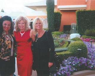 In this photo from April, Deborah Carissimi, left, Terri Goldner and Carla Carissimi pause in the Las Vegas flower gardens at The Wynn Resort. Photo sent in by Deborah Carissimi of Boardman.