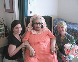 """These """"blossoms"""" at Danridge's Burgundi Manor in Youngstown are, from left, Shelly Frangos, activities; Haggir Moorer, short-term rehabilitation resident; and Toni Krager, corporate marketing director."""