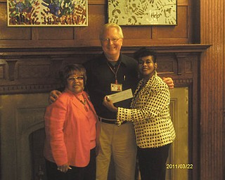 Instead of buying and exchanging gifts for one another, members of Youngstown Chapter of The Links Inc. made a donation to the Rescue Mission of Mahoning Valley. Vice President Janice Beachum, left, and President Krishmu Shipmon, right, presented the check to James Echement, executive director of the Rescue Mission. Links is an international volunteer service organization that strives to affect the quality of life through community service.