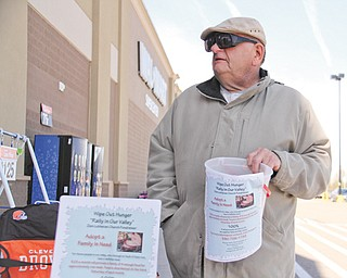 Charlie Granger of Austintown holds a bucket in front of the Walmart in Austintown for donations to Zion Luthern Church to help feed the needy.