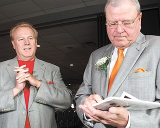 Cleveland sports personality Bruce Drennan, right, signs an autograph for Frank Frattaroli of Struthers during the Curbstone Coaches Hall of Fame Banquet on Sunday at Mr. Anthony's in Boardman.
