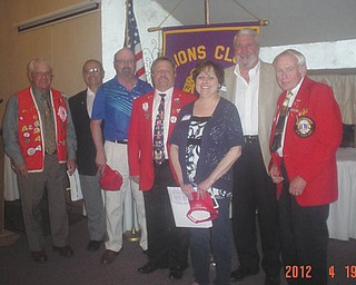 King Lion Harry Pancher, president of the Canfield Lions Club, offers thanks to all who made the 2012 craft show a success, as well as the fish dinners at A La Cart Catering. At a recent Lions Club dinner meeting, a special get-acquainted program offered by Lion Phil Bova was a huge success. District 13-D vice governor-elect Tom Zickefoose installed four members into the club. Lions above, left to right, are Bova, sponsor; Ed De Angelo; Mike Walsh, new Lions; Vice Gov. Tom Zickefoose, installing officer; Marian Zickefoose, new Lions; Tom Krispli, new Lions; and P.D.G. Lion Ted Filmer, sponsor.