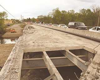 Motorists experienced some delays Friday afternoon on the Parkman Road Northwest bridge over the Mahoning River in Warren as a result of the $4.6 million construction project being carried out to replace the bridge. The project most likely will continue into 2013.