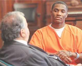Melvin Shaw converses with his attorney Thomas Zena during a suppression hearing before Judge James C. Evans of Mahoning County Common Pleas Court. Shaw is accused of killing a 17-year-old girl and wounding her 18-year-old friend in 2010. The trial is expected to get under way today with jury selection.