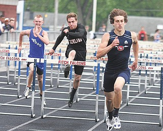 Fitch sophomore Sam Ortz, right, pulls away for the victory in the 110-meter hurdles at Tuesday's All-American Conference American Division track meet at Fitch High School.