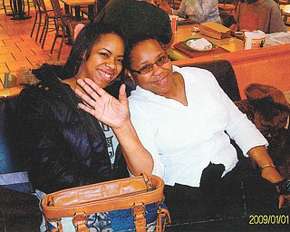 Mom Theresa Adams and daughter Patrice Adams, both of Youngstown, share a moment together. Patrice submitted a poem in honor of her mother.