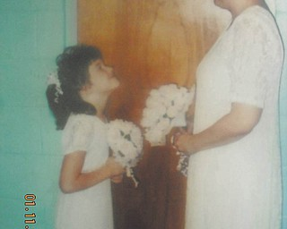 """This photo was taken 10 years ago of Heather Atkinson and her mother, Sharon Pink, both of East Palestine, at Sharon's wedding. Heather, now 18, says her mom has been her best friend her whole life, and that """"being her baby and only child, we look forward to the day this photo can be taken again ... at my wedding."""""""