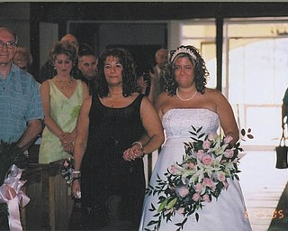 """""""A mom, a dad, a coach, a teacher, a fan, a supporter and most of all, a best friend"""" is how Jessica Hallquist describes her mother, Carol Crytzer. Both are from Struthers. Jessica says it was such an honor to have her mom walk Jessica down the aisle at her wedding."""